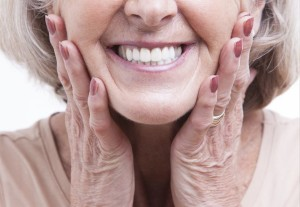 Senior woman with dentures - Fifth Avenue Endodontics